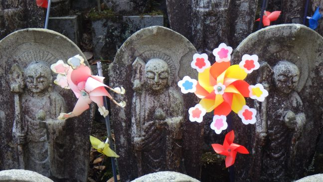 Jizo with pinwheels