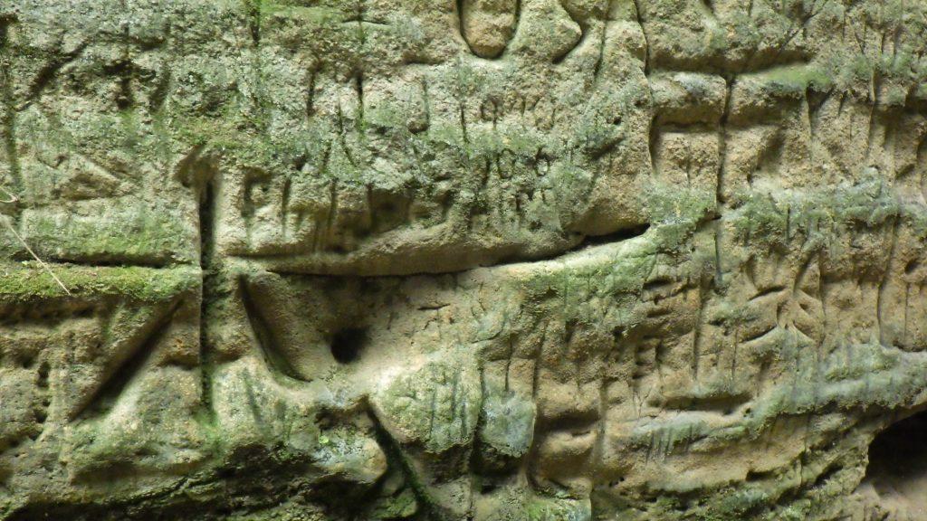 Graffiti inscriptions in the stone walls
