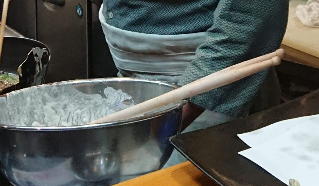 Drumsticks used to stir tempura batter