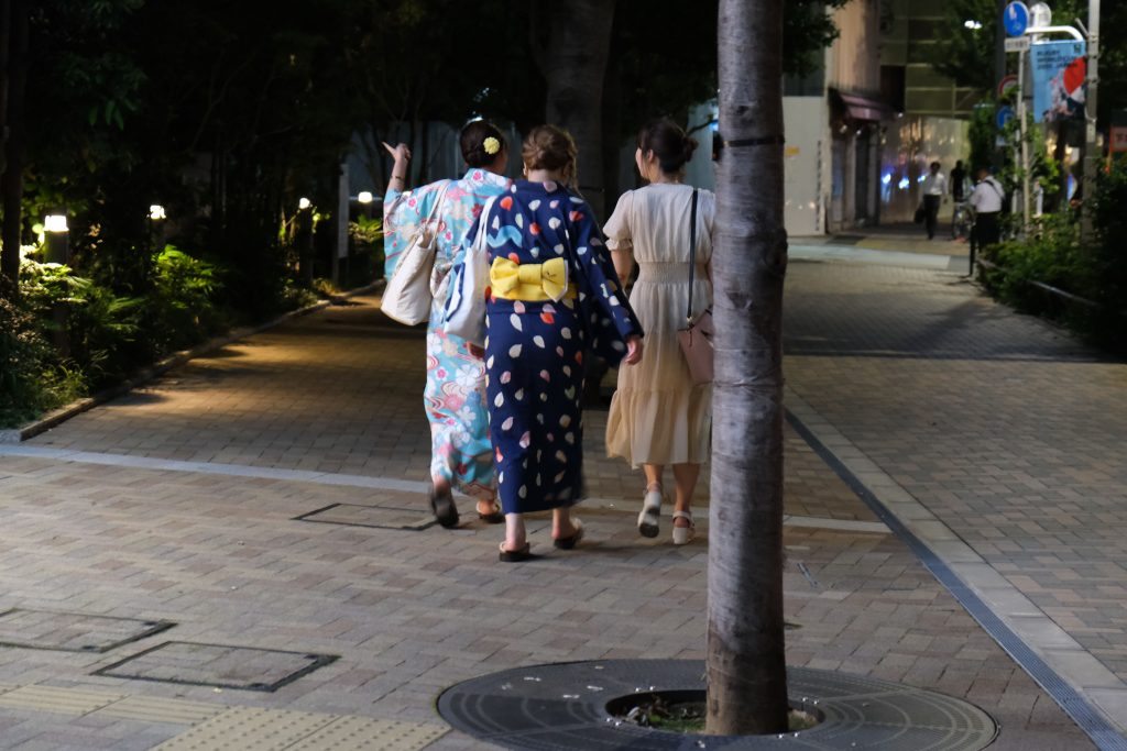 Ladies on the sidewalk in kimono