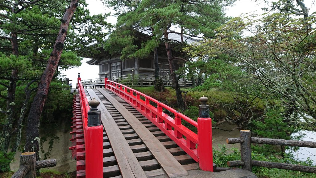 Red arching bridge leading to Godaido