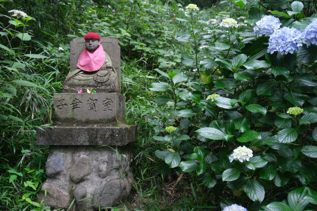 Jizo among hydrangea blossoms